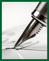 A pen signing on a document