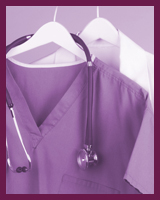 Medical scrubs hanging up with a stethoscope